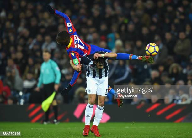 Claudio Yacob of West Bromwich Albion challenges Christian Benteke of Crystal Palace during the Premier League match between West Bromwich Albion and...