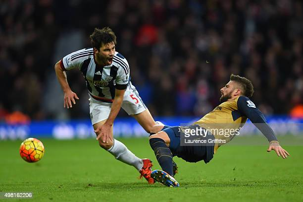 Claudio Yacob of West Bromwich Albion is tackled by Olivier Giroud of Arsenal during the Barclays Premier League match between West Bromwich Albion...