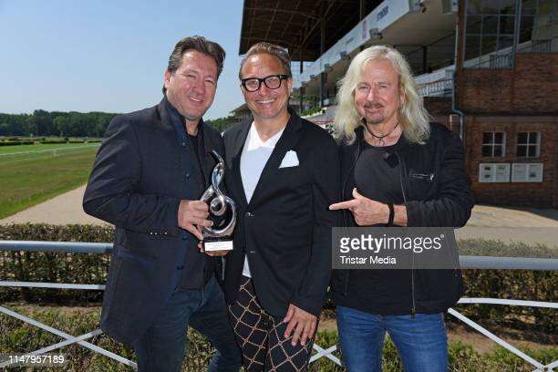 Claudius Dreilich and Bernd Roemer of the band Karat and Oliver Dunk attend the Radio B2 'SchlagerHammer' press conference on June 4 2019 in Berlin...