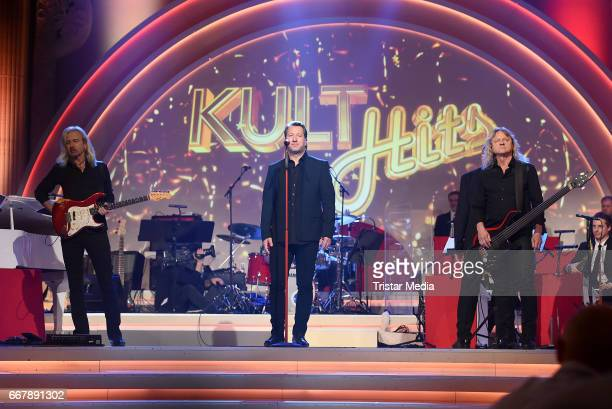 Claudius Dreilich Bernd Roemer and Christian Liebig of the band Karat perform during the show 'KULTHITS Die Show mit 100% Livemusik' presented by Kim...