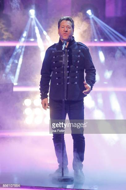 Claudius Dreilich singer of the band Karat performs with Rock Legenden during the tv show 'Willkommen bei Carmen Nebel' at TUI Arena on September 30...