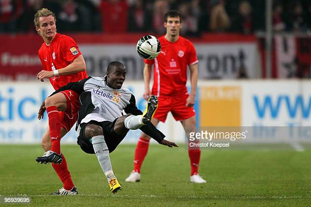 Claus Costa of Duesseldorf and John Jairo Mosquera of Union Berlin go up for a header during the Second Bundesliga match between Fortuna Duesseldorf...