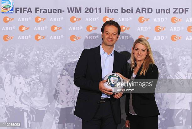 Claus Lufen and Nia Kuenzer pose during a photocall with the ARD and ZDF TV presenters for the FIFA Women World Cup 2011 at the Commerzbank Arena on...