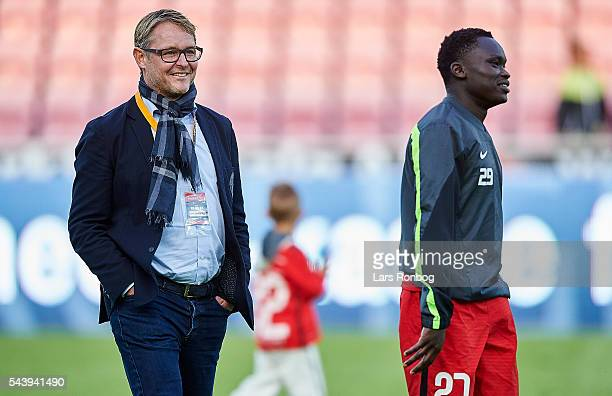 Claus Steinlein, sports director of FC Midtjylland and Pione Sisto of FC Midtjylland walks off the pitch after the Europa League Qualifier match...