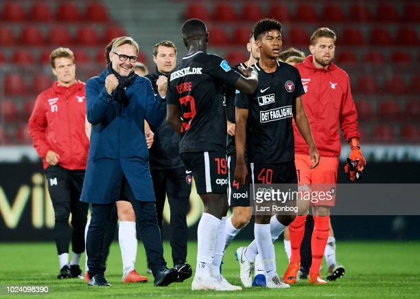 Claus Steinlein sports director of FC Midtjylland celebrates with Mayron George of FC Midtjylland after the Danish Superliga match between FC...