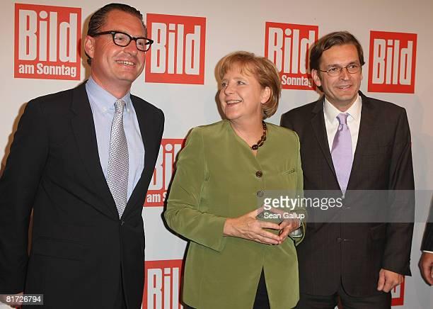 Claus Strunz editorinchief of the German Sunday tabloid Bild am Sonntag German Chancellor Angela Merkel and tabloid newspaper Bild editorinchief Kai...