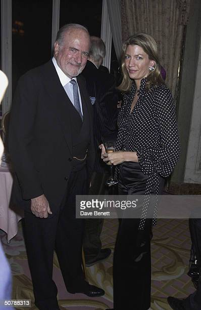 Claus Von Bulow with his daughter Cosima at the book launch for Annabel Goldsmith's Memoirs at the Ritz Hotel on 11th March 2004 in London