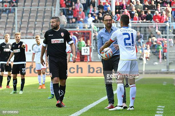 ClausDieter Wollitz of Cottbus gives the ball to Marcel Costly of Mainz during the Third League match between Energie Cottbus and 1 FSV Mainz 05 II...