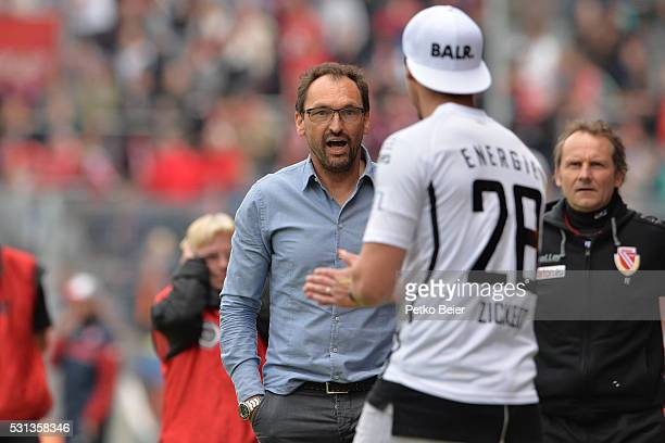 ClausDieter Wollitz of Cottbus talks to Jonas Zickert of Cottbus during the Third League match between Energie Cottbus and 1 FSV Mainz 05 II at...