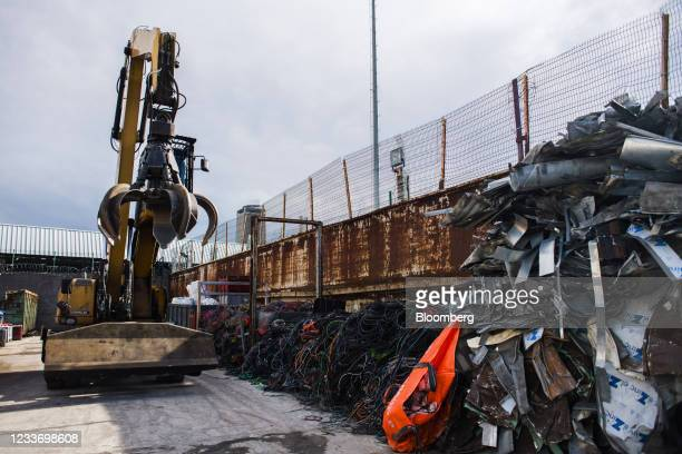 Claw crane operates beside assorted scrap metal at a metals recycling yard in Paris, France, on Monday, June 28, 2021. Commoditieshave rallied 18%...