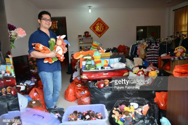 Claw machine master Chen Zhitong shows some of his collection of trophies from claw machines at home on April 01 2017 in Xiamen China The 36yearold...