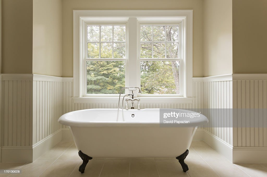 Clawfoot bathtub in custom designed bathroom. : ストックフォト