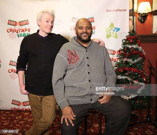 Clay Aiken and Ruben Studdard attend the Broadway Preview Photo Call for 'Ruben Clay's First Annual Christmas Carol Family Fun Pageant' at Sardi's on...