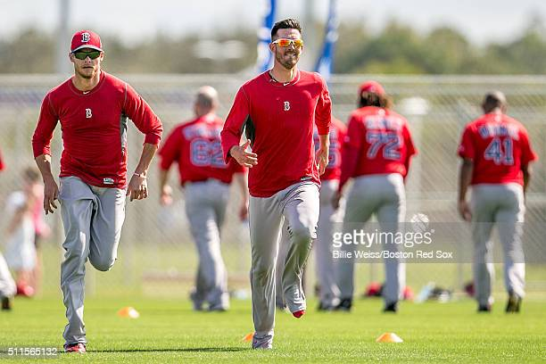 Clay Buchholz and Rick Porcello of the Boston Red Sox run sprints during a workout on February 21 2016 at Fenway South in Fort Myers Florida