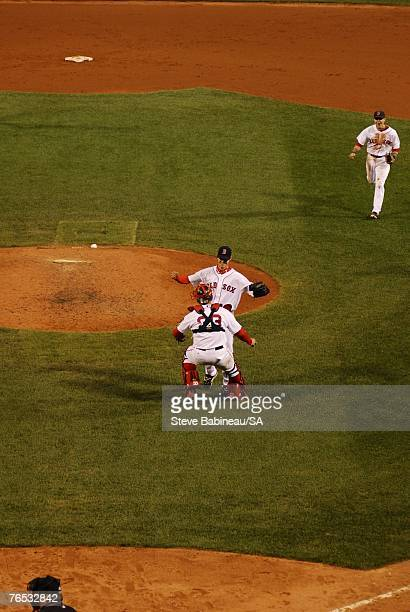 Clay Buchholz of the Boston Red Sox celebrates with teammates after the victory against the Baltimore Orioles on September 1, 2007 at Fenway Park in...