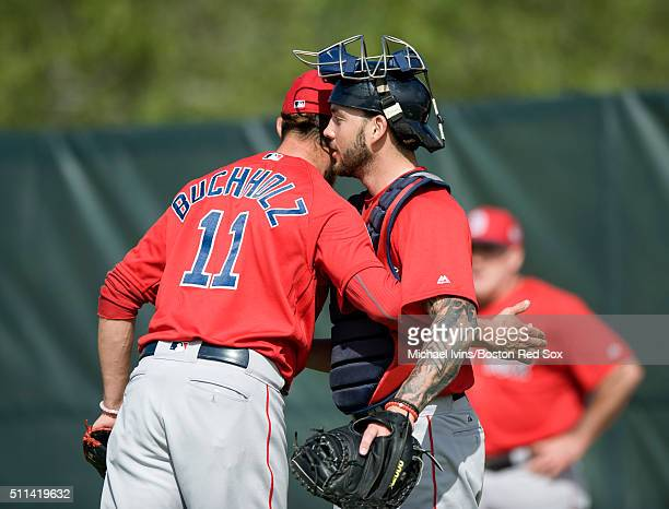 Clay Buchholz of the Boston Red Sox hugs Blake Swihart following a bullpen session on February 20 2016 at Fenway South in Fort Myers Florida