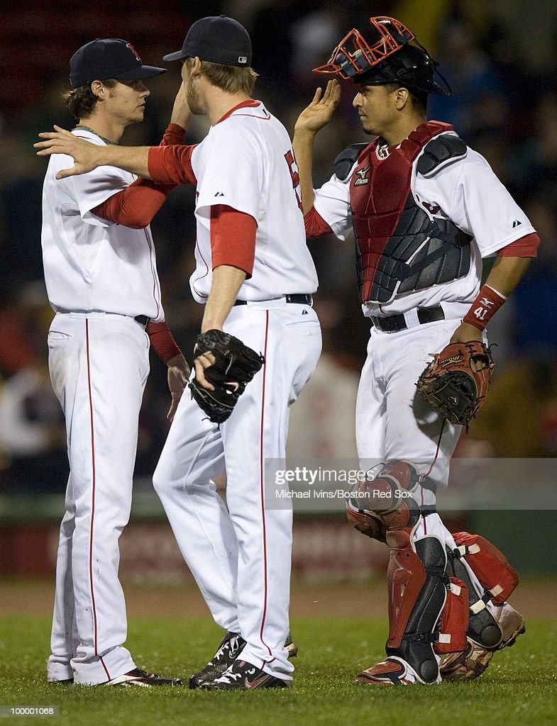 Clay Buchholz #11 of the Boston Red Sox is congratulated by Daniel Bard #51 and Victor Martinez #41 after a game against the Minnesota Twins on May 19, 2010 at Fenway Park in Boston, Massachusetts. Boston won 3-2.