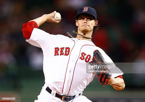 Clay Buchholz of the Boston Red Sox pitches against the Tampa Bay Rays in the first inning during the game at Fenway Park on September 23 2014 in...