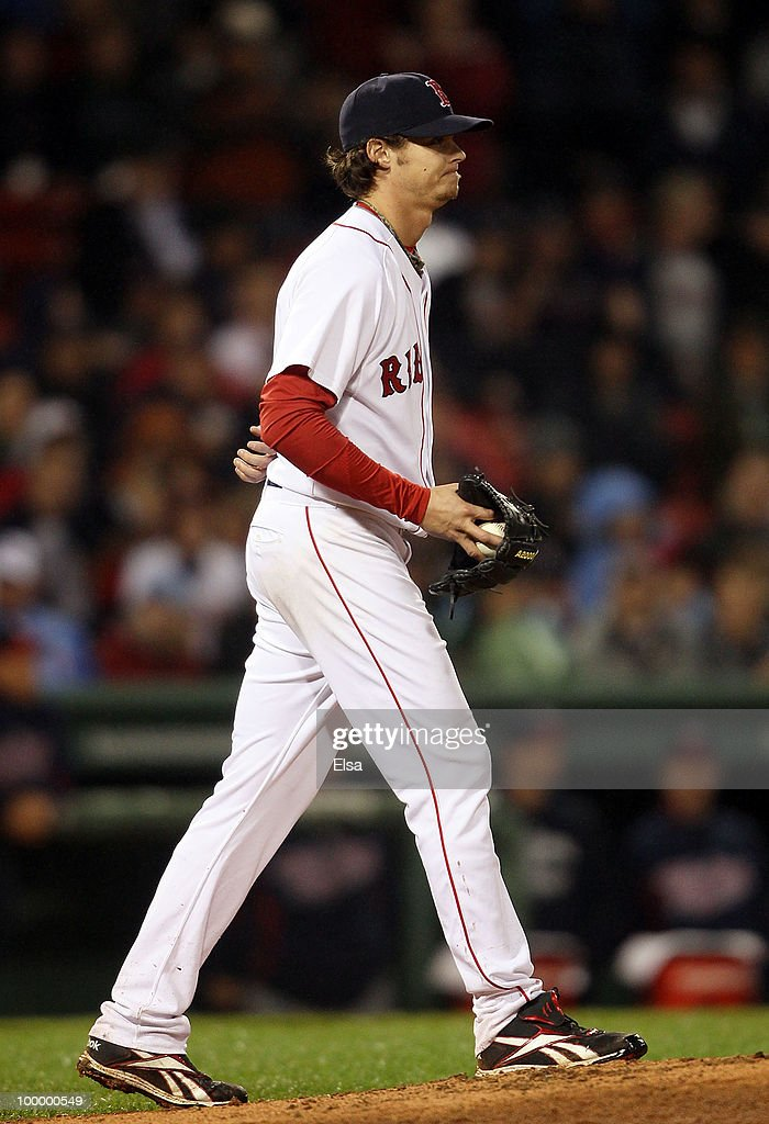 Clay Buchholz #11 of the Boston Red Sox reacts before he is pulled from the game in the top of the ninth inning against the Minnesota Twins on May 19, 2010 at Fenway Park in Boston, Massachusetts.