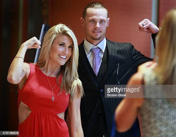 Clay Buchholz of the Boston Red Sox right and his wife Lindsay left strike a pose for a photo at the third annual David Ortiz Children's Fund Gala...