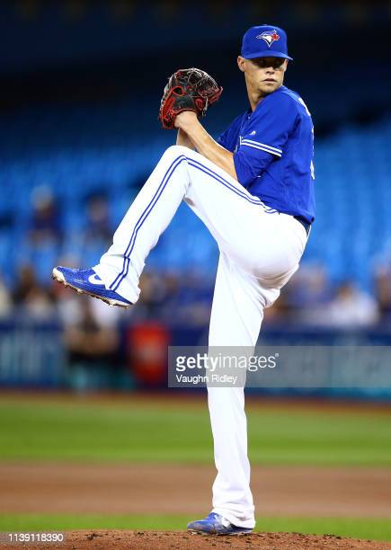 Clay Buchholz of the Toronto Blue Jays delivers a pitch in the first inning during a MLB game against the San Francisco Giants at Rogers Centre on...
