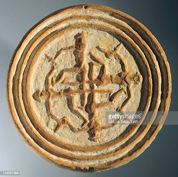 Clay cake mold made in the furnaces of the Royal Palace of Mari Syria Sumerian civilisation 18th Century BC Aleppo Archaeological Museum