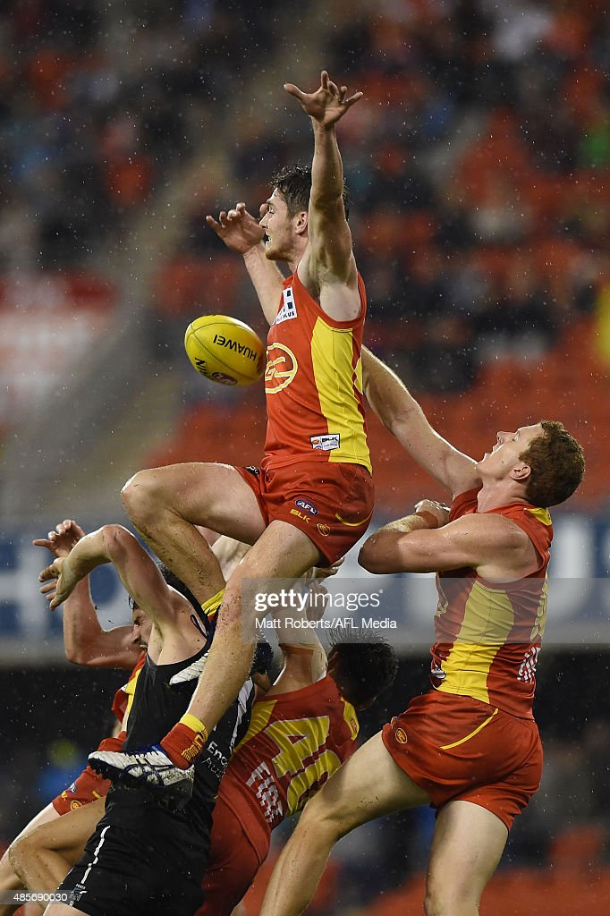 Clay Cameron of the Suns competes for the ball during the round 22 AFL match between the Gold Coast Suns and the Port Adelaide Power at Metricon Stadium on August 29, 2015 on the Gold Coast, Australia.