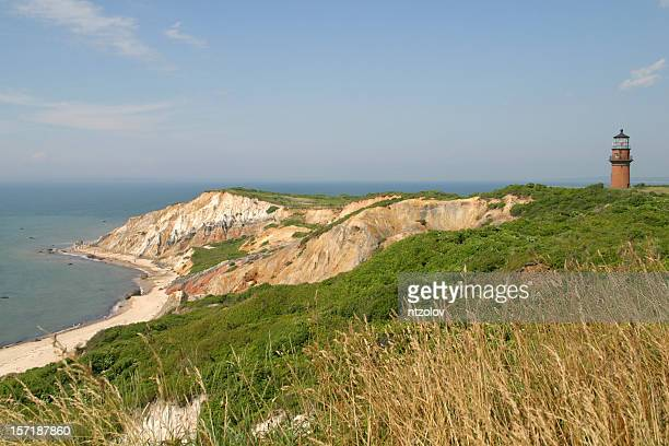 clay cliffs of aquinnah and lighthouse - marthas vineyard stock pictures, royalty-free photos & images
