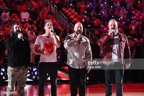Clay Cook Jimmy De Martini Zac Brown and John Driskell Hopkins of The Zac Brown Band perform the national anthem prior to Dallas Mavericks Vs Atlanta...