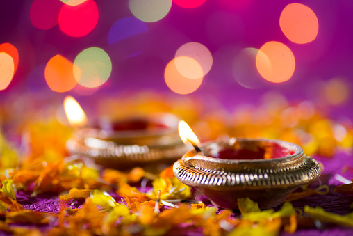 Clay diya lamps lit during Diwali Celebration. Greetings Card Design Indian Hindu Light Festival called Diwali 1208784124