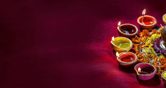 Clay diya lamps lit during Diwali Celebration. Greetings Card Design 607777600