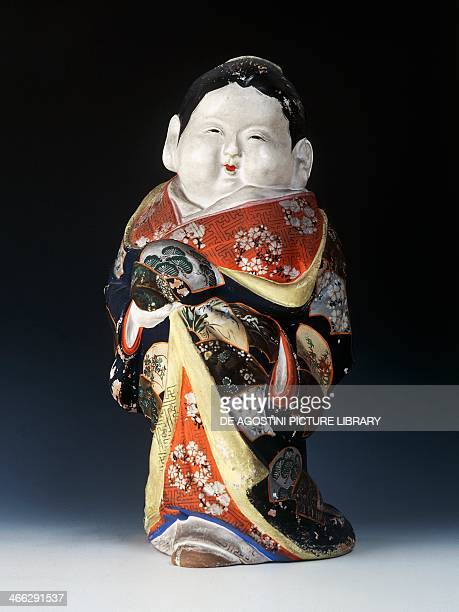 Clay figurine depicting Okame strong female figure and a symbol of the joy of sexual pleasure height 39 cm Japanese civilisation Meiji period 18681912