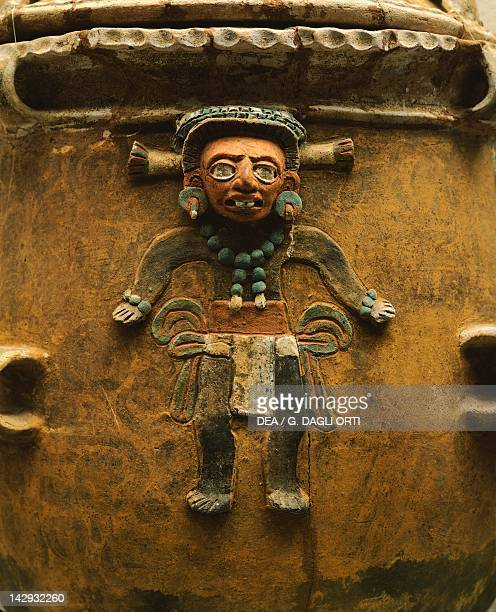 Clay funeral urn originating from Nebaj Quiche Detail showing a depiction of man on his feet Mayan Civilization 4th10th Century Citta' Del Guatemala...
