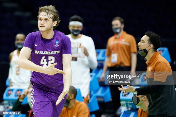 Clay Gayman of the Abilene Christian Wildcats celebrates his three point basket against the Texas Longhorns during the first half in the first round...