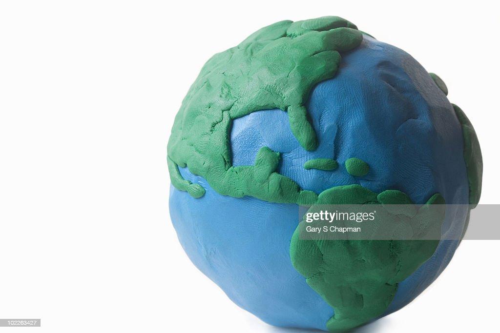 Clay globe modeled by child  : ストックフォト