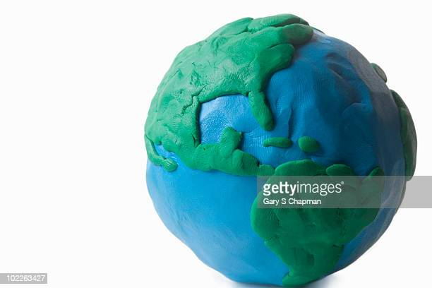 clay globe modeled by child  - clay stock pictures, royalty-free photos & images