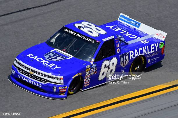 Clay Greenfield driver of the Rackley Roofing Chevrolet practices for the NASCAR Gander Outdoor Truck Series NextEra Energy 250 at Daytona...