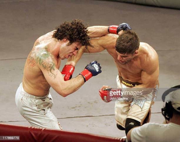 """Clay Guida absorbs a punch by Josh Thompson during the """"StrikeForce"""" professional mixed martial arts event March 10, 2006 at HP Pavilion in San Jose,..."""