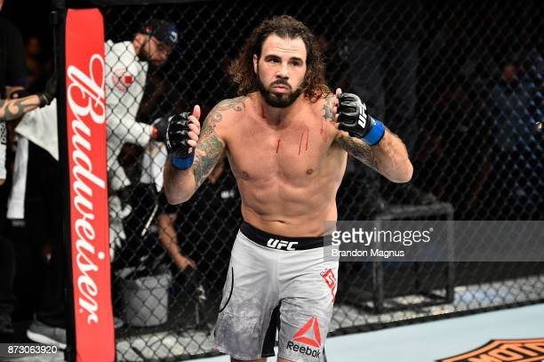 Clay Guida celebrates after defeating Joe Lauzon in their lightweight bout during the UFC Fight Night event inside the Ted Constant Convention Center...