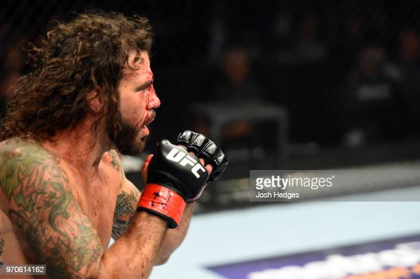 Clay Guida faces Charles Oliveira of Brazil in their lightweight fight during the UFC 225 event at the United Center on June 9 2018 in Chicago...