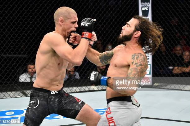 Clay Guida punches Joe Lauzon in their lightweight bout during the UFC Fight Night event inside the Ted Constant Convention Center on November 11...