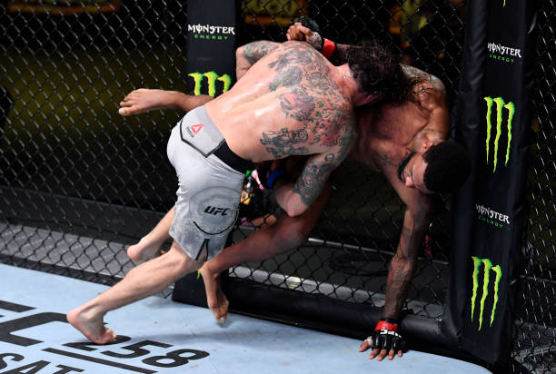 Clay Guida takes down Michael Johnson in their lightweight fight during the UFC Fight Night event at UFC APEX on February 06, 2021 in Las Vegas,...