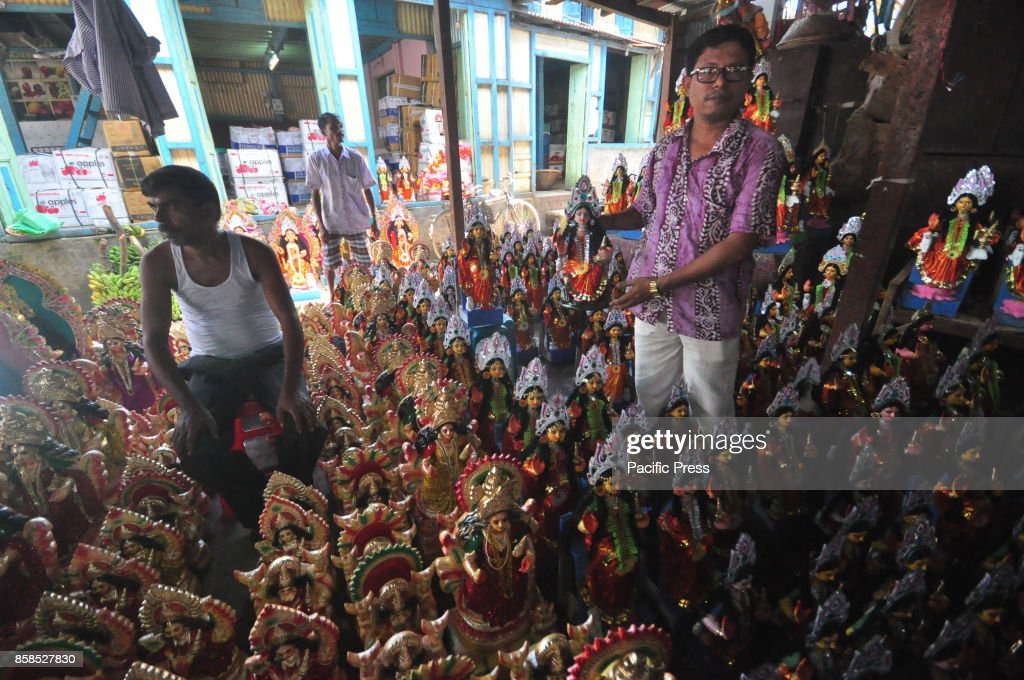 clay idols of hindu goddess lakshmi are displayed for sale
