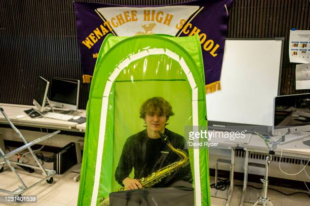 Clay Lancaster poses for a portrait with a tenor saxophone in his pop-up tent during wind ensemble class at Wenatchee High School on February 26,...