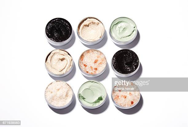clay masks and salt treatments on a grid - cosmetics stock pictures, royalty-free photos & images