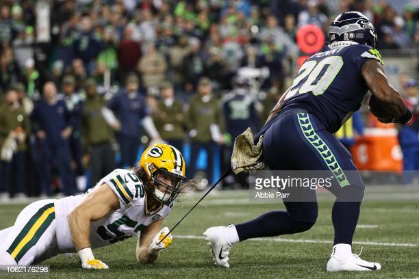 Clay Matthews of the Green Bay Packers attempts to tackle Rashaad Penny of the Seattle Seahawks in the first half at CenturyLink Field on November...