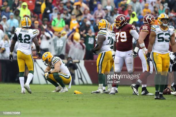 Clay Matthews of the Green Bay Packers reacts after being called for a penalty in the third quarter against the Washington Redskins at FedExField on...