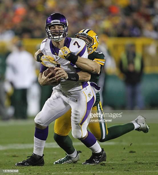 Clay Matthews of the Green Bay Packers sacks Christian Ponder of the Minnesota Vikings at Lambeau Field on November 14 2011 in Green Bay Wisconsin...