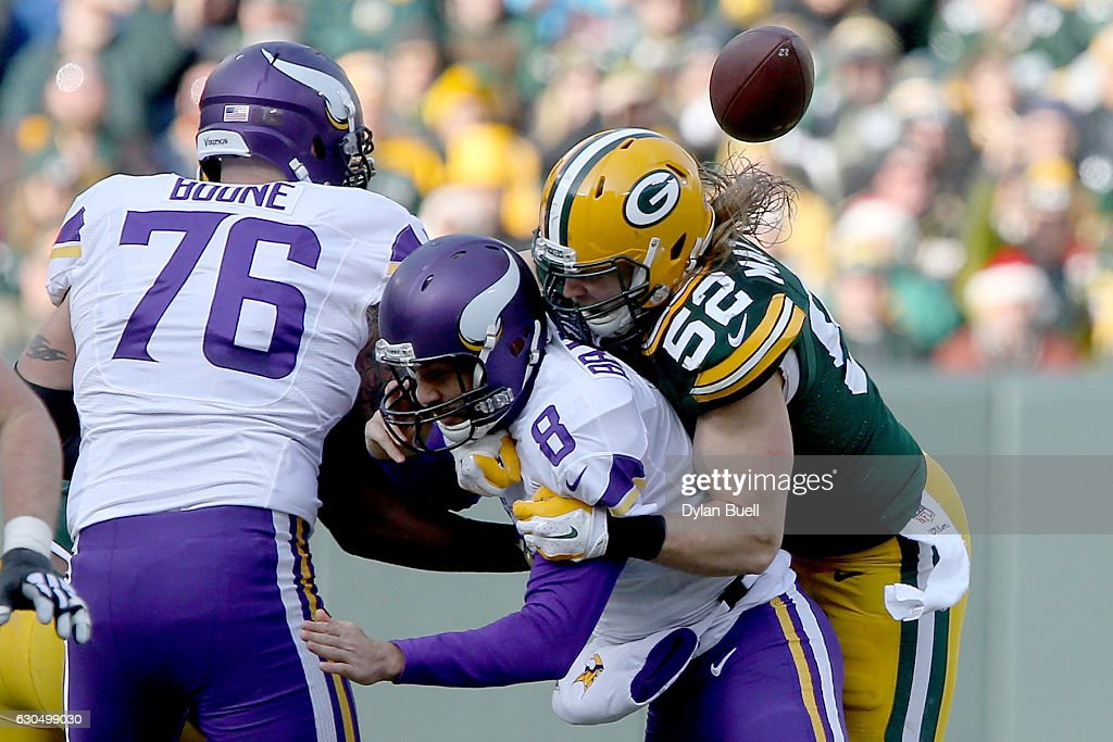 Clay Matthews #52 of the Green Bay Packers sacks Sam Bradford #8 of the Minnesota Vikings in the second quarter at Lambeau Field on December 24, 2016 in Green Bay, Wisconsin.