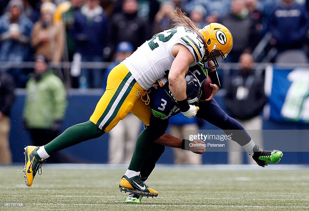 Clay Matthews #52 of the Green Bay Packers tackles Russell Wilson #3 of the Seattle Seahawks durnig the third quarter of the 2015 NFC Championship game at CenturyLink Field on January 18, 2015 in Seattle, Washington.